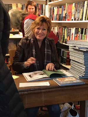 Signing books at the King's English Book Shop